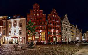 Картинка Германия Дома Улица Ночные Скамейка Stralsund Города