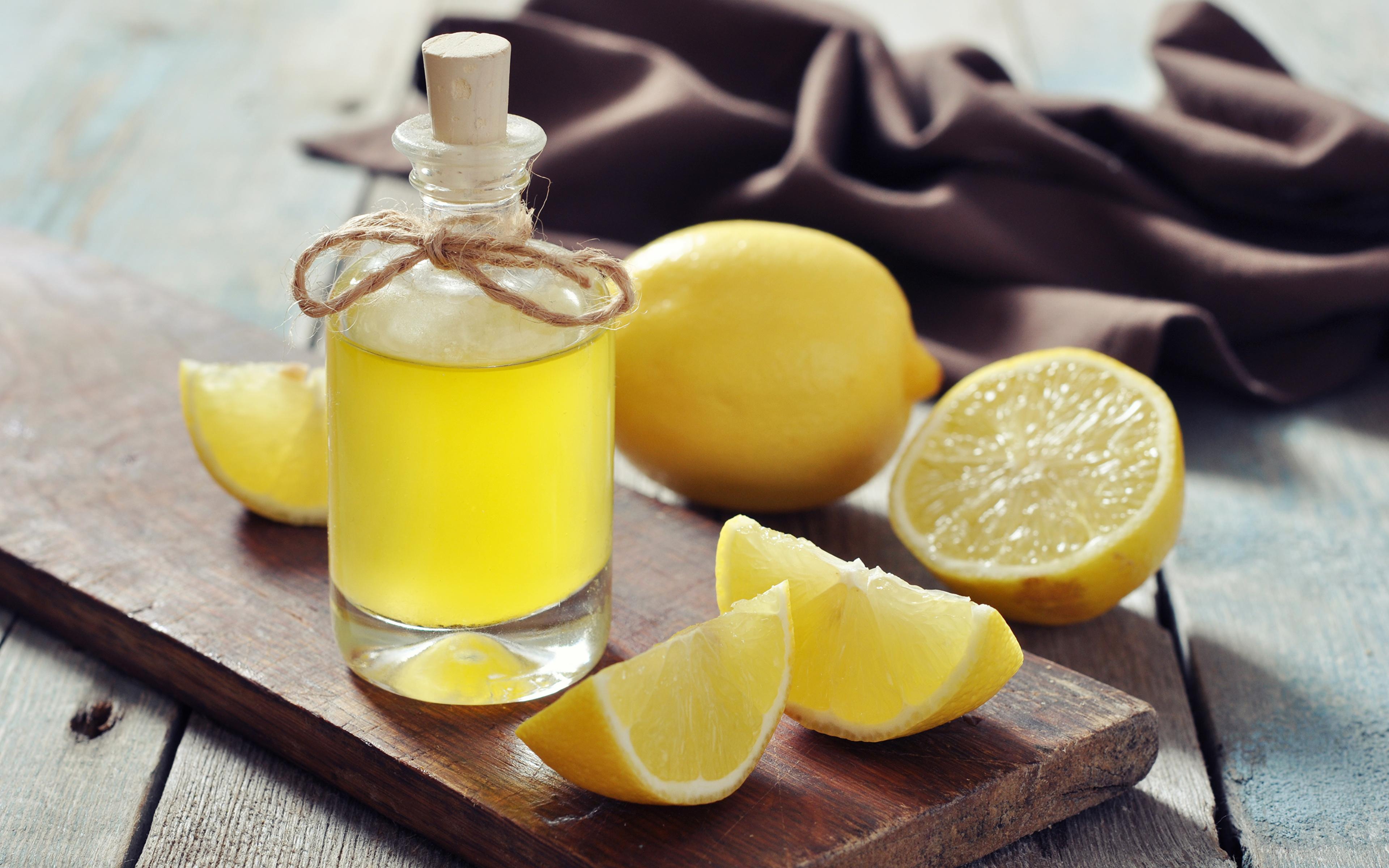 Картинки Сок Лимоны Бутылка Продукты питания Крупным планом Напитки 3840x2400 Еда Пища бутылки вблизи напиток