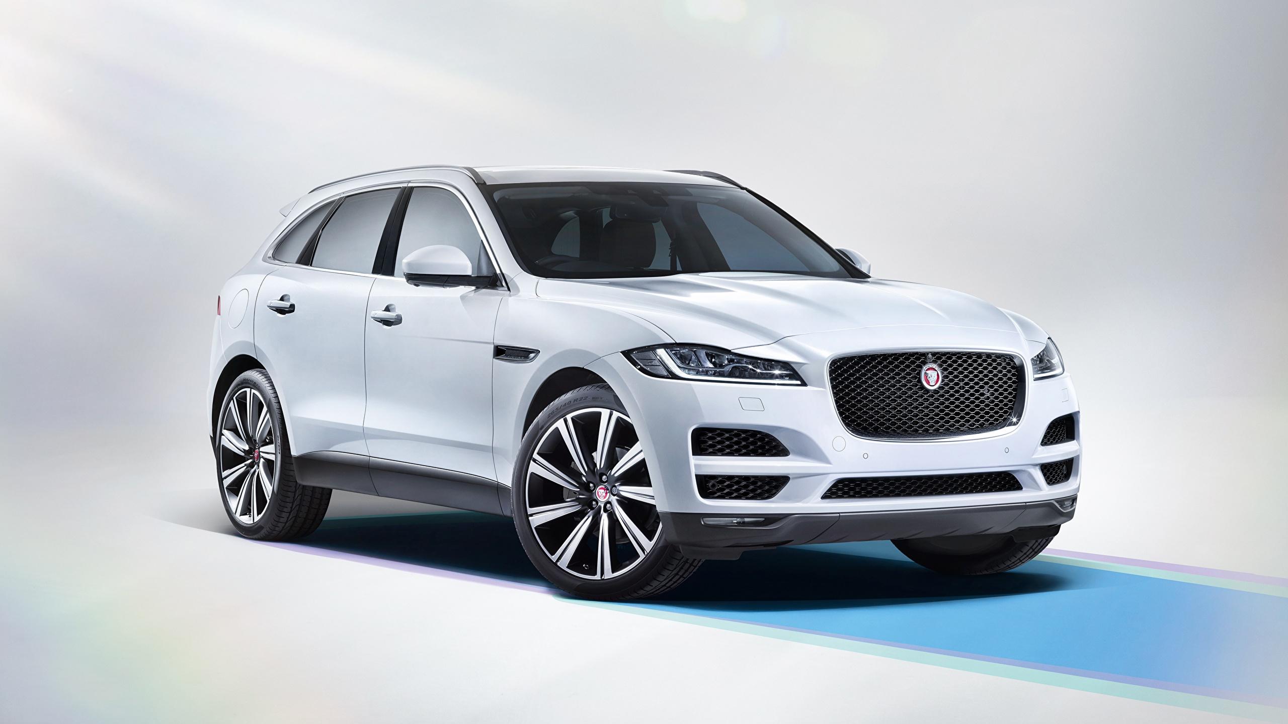 Фотографии Ягуар Кроссовер F-Pace, Portfolio 20d AWD, UK-spec, 2016 белые автомобиль 2560x1440 Jaguar CUV белая Белый белых авто машины машина Автомобили