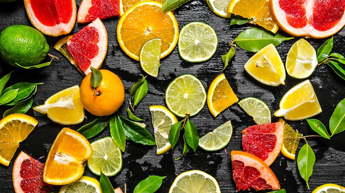Картинки Лайм Лимоны Продукты питания Нарезанные продукты Цитрусовые 1366x768 Еда Пища нарезка
