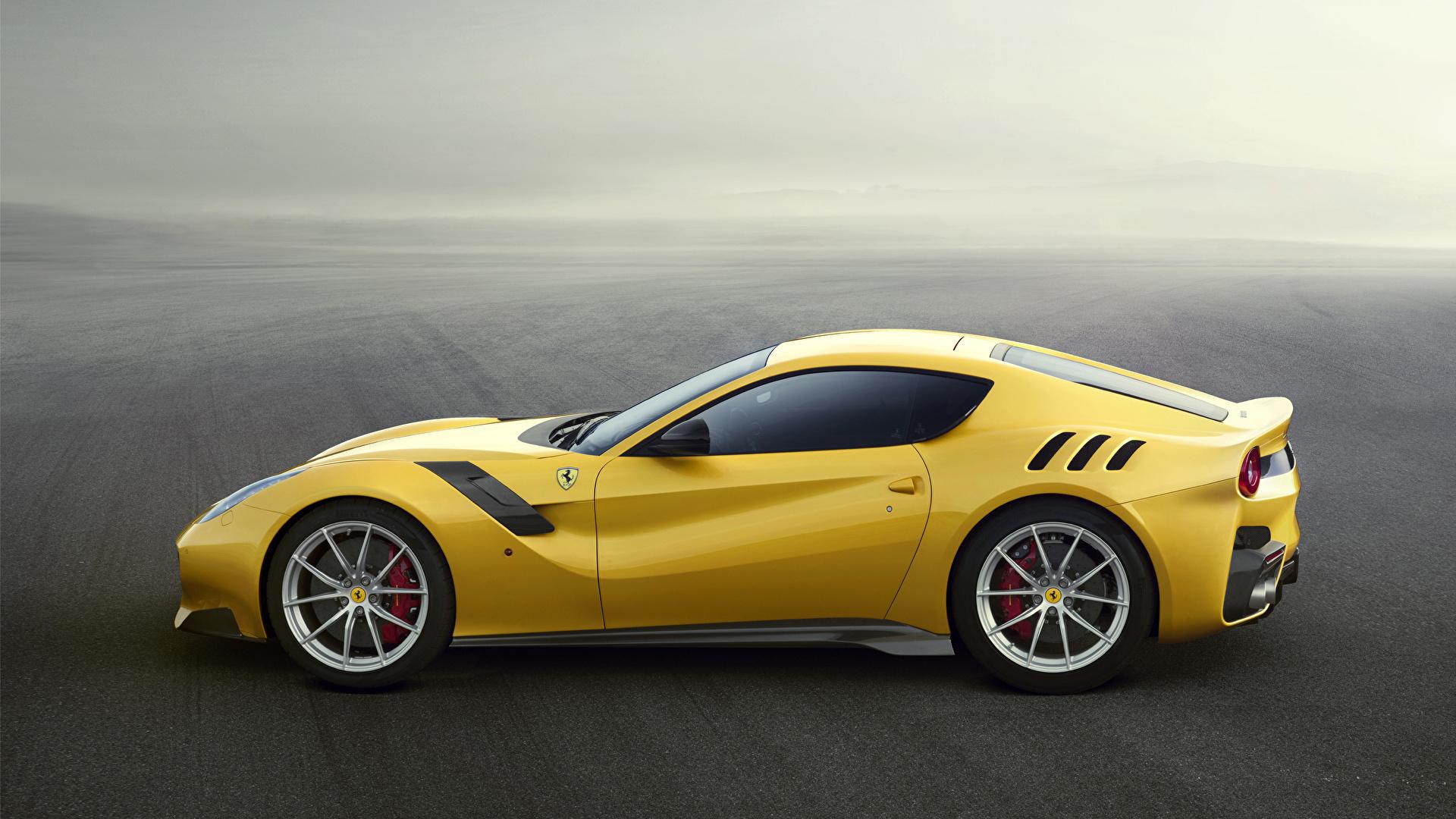 Фотографии 2015 Ferrari F12 TDF Berlinetta желтые авто Сбоку 1920x1080 Феррари желтых Желтый желтая машина машины автомобиль Автомобили