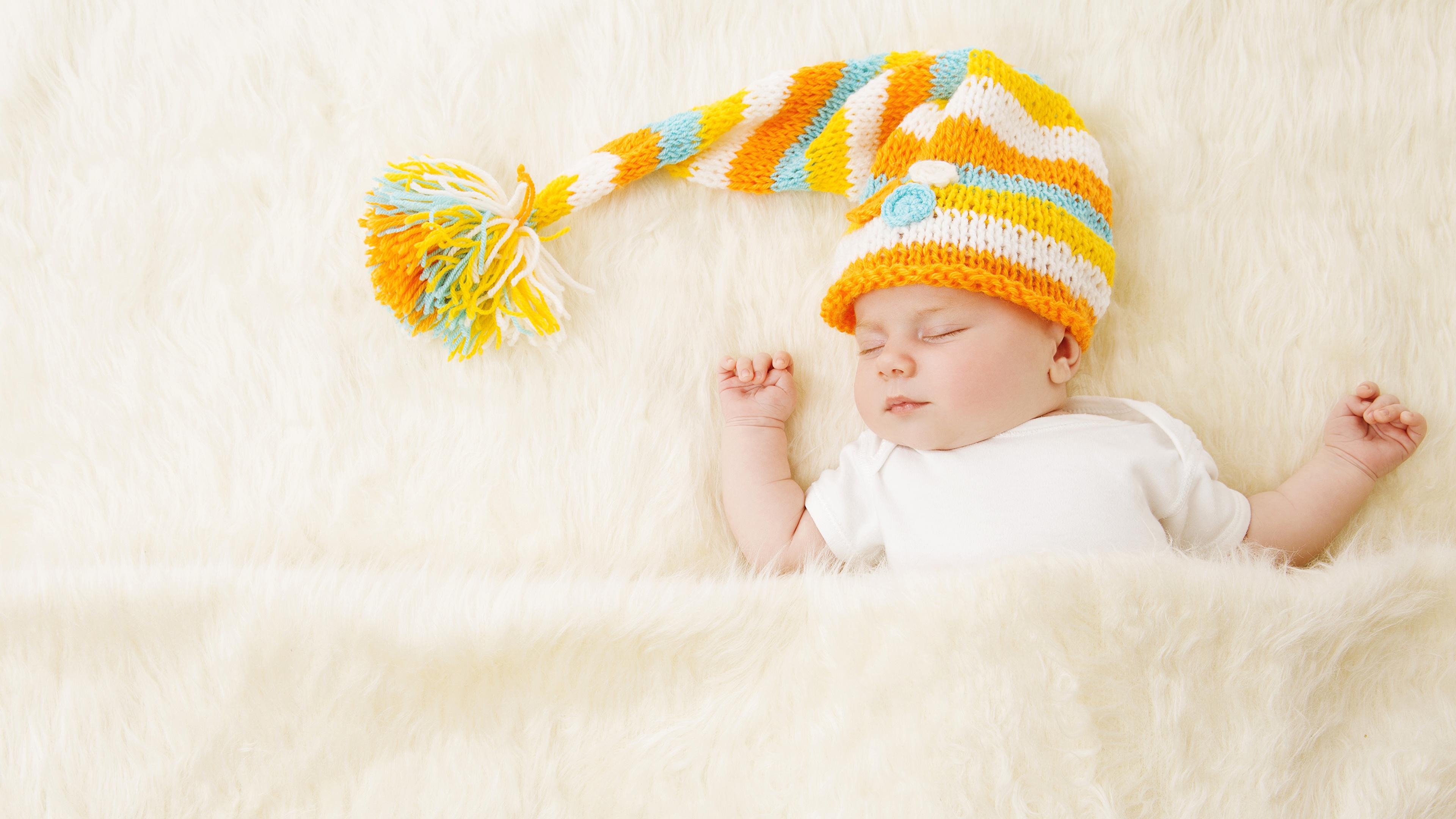 Картинка грудной ребёнок ребёнок Спит шапка 3840x2160 младенца младенец Младенцы Дети сон спят Шапки спящий в шапке