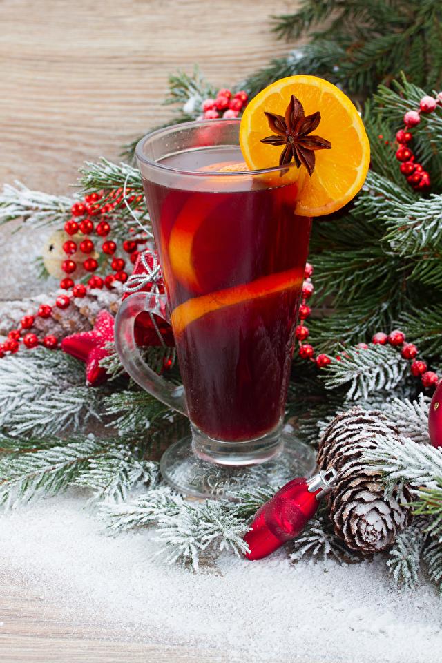 Фотографии Новый год Бадьян звезда аниса Стакан Лимоны Еда шишка на ветке Напитки 640x960 Рождество стакана стакане Пища Шишки Ветки ветвь ветка Продукты питания