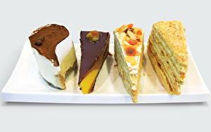 Фотография Сладкая еда Торты Шоколад Цветной фон Еда