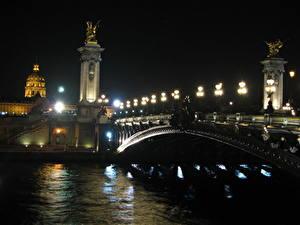 Картинки Франция Мосты Речка Ночь Уличные фонари Paris город