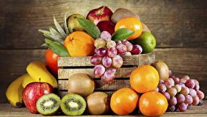 Картинки Фрукты Киви Апельсин Виноград Яблоки Продукты питания