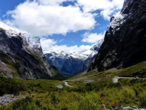 Фотографии Новая Зеландия Парки Гора Облака Траве Fiordland Природа