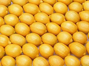 Обои Фрукты Лимоны Много Текстура Продукты питания
