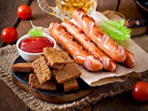 Картинки Мясные продукты Сосиска Хлеб Помидоры Кетчупом Продукты питания