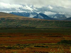 Фотографии Гора Поля Облачно Природа