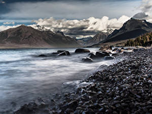 Фотография Озеро Гора Зима Камни Пейзаж Облачно Природа