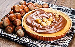 Фотографии Выпечка Пирог Орехи Сладости Шоколад Крупным планом Продукты питания
