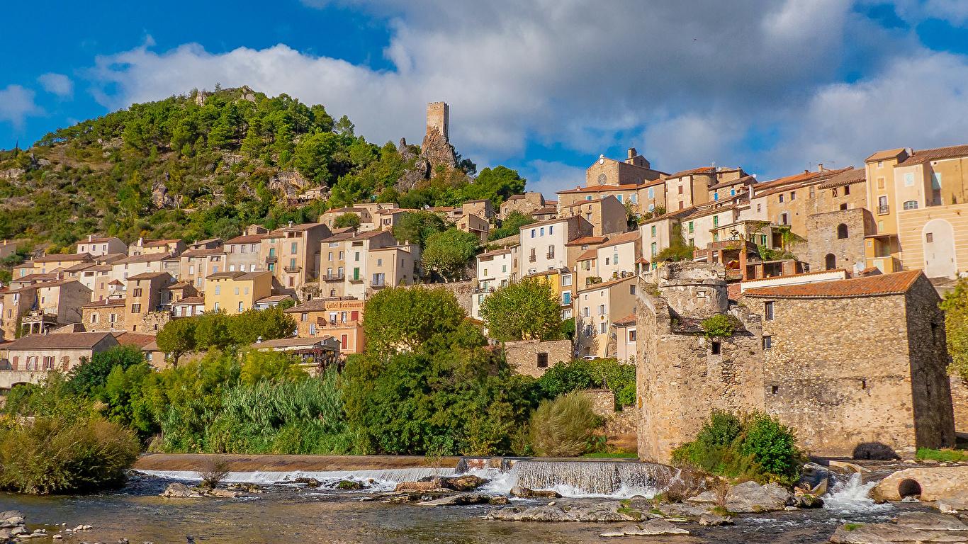 Фотография Франция Roquebrun холм Побережье Здания Города 1366x768 Холмы холмов берег Дома город