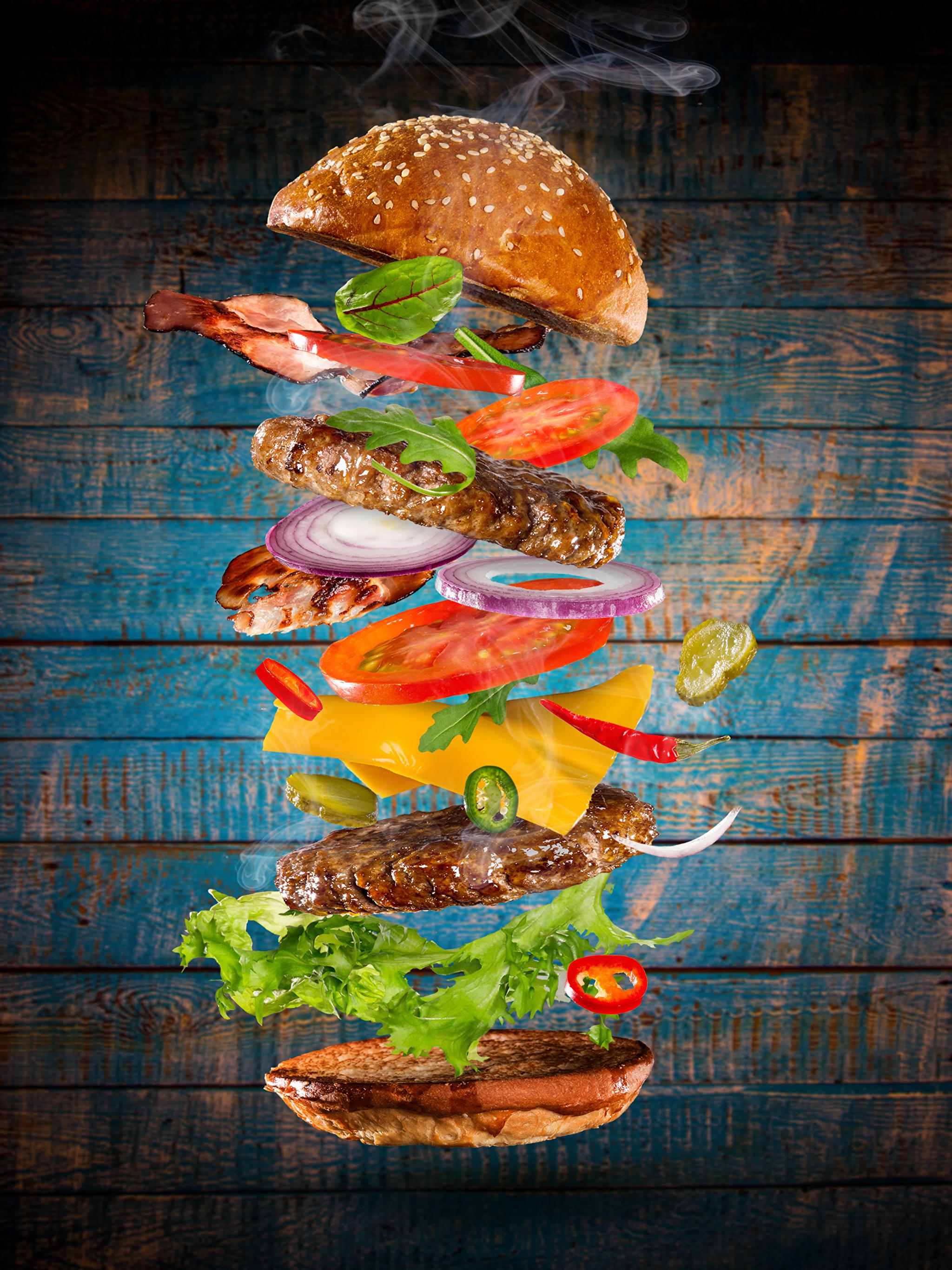 Фото Гамбургер Булочки Быстрое питание Пища Овощи Мясные продукты Доски 2048x2732 Фастфуд Еда Продукты питания