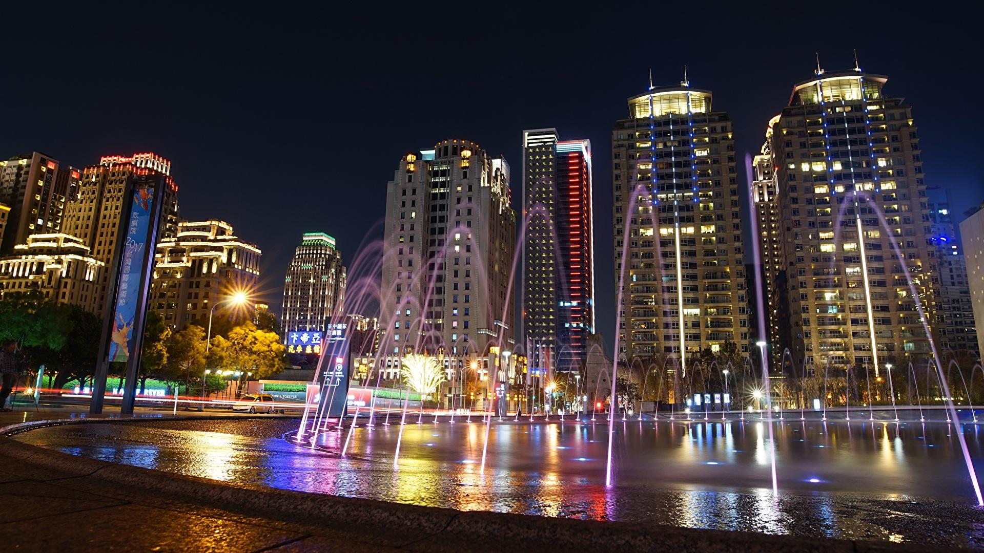 Картинка Тайбэй Китай Фонтаны Ночные Дома Города 1920x1080 Ночь ночью в ночи Здания
