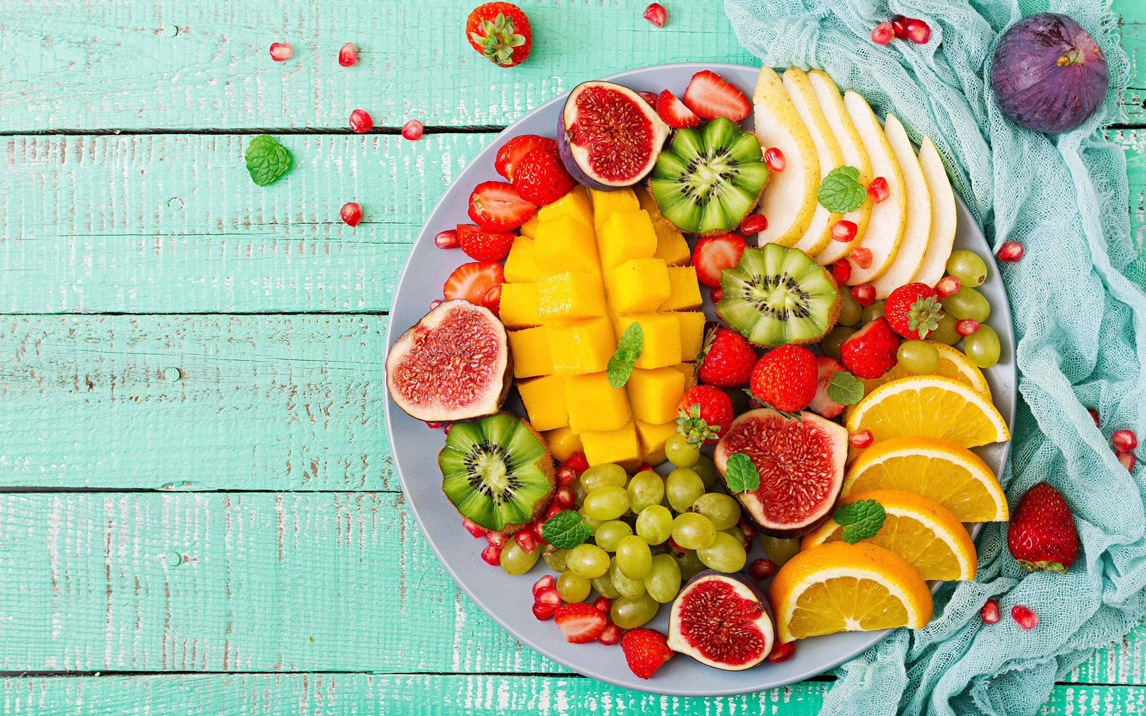 Фотография Манго Инжир Апельсин Киви Фрукты Продукты питания 3840x2400 Еда Пища