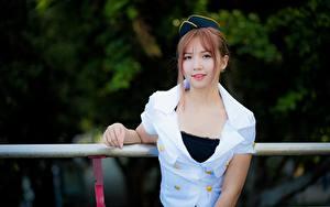 Фотографии Азиатки Униформе Стюардессы Смотрят молодые женщины