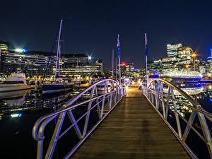 Обои для рабочего стола Австралия Дома Причалы Мост Вечер Лучи света Melbourne город