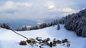 Фотографии Австрия Горы Зима Здания Альп Снег Облачно Деревня Bad Dürrnberg Природа