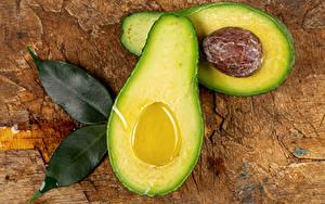 Картинка Авокадо Вблизи Листья Продукты питания