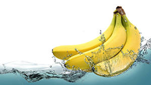 Фотографии Бананы Вода Брызги Продукты питания