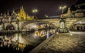 Обои Бельгия Дома Речка Мост Брюгге Уличные фонари Ночь Города