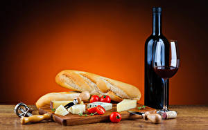 Фотографии Хлеб Сыры Томаты Вино Бутылки Бокалы Продукты питания