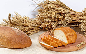 Фотография Хлеб Разделочной доске Нарезка Колосок Пища