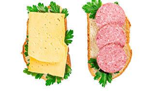Картинки Бутерброд Хлеб Сыры Колбаса Белым фоном Двое Пища