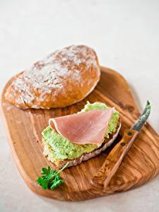 Фотография Бутерброд Ветчина Овощи Булочки Серый фон Разделочной доске Пища