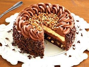 Фото Торты Шоколад Орехи Сладости Вблизи Продукты питания