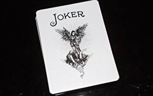Обои Карты Крупным планом На черном фоне joker