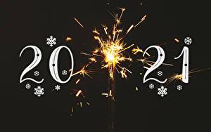 Фото Новый год 2021 Снежинки Бенгальские огни На черном фоне