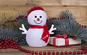 Фото Рождество Ветвь Снеговики Шарф Подарки Шапки