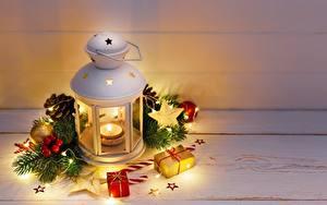 Фото Рождество Свечи Лампы Гирлянда Ветки Звездочки Шарики Подарки Шишки