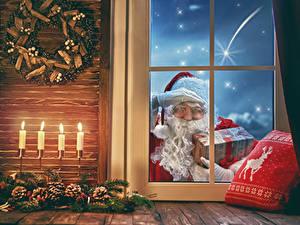 Фото Рождество Свечи Окно Шишки Санта-Клаус Подарки