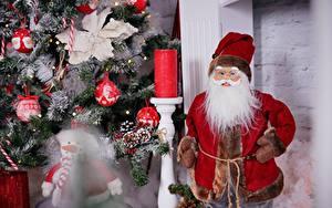 Фотографии Рождество Новогодняя ёлка Санта-Клаус Бородатый Шапка
