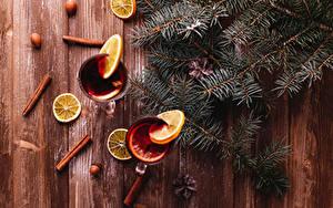 Фотография Новый год Корица Лимоны Орехи Напитки Доски Ветки Еда