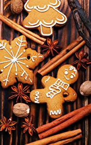 Фотографии Новый год Корица Бадьян звезда аниса Печенье Грецкий орех Еда