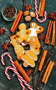 Картинка Рождество Корица Бадьян звезда аниса Орехи Печенье Сладости Продукты питания