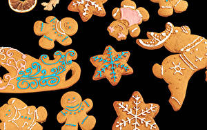 Картинки Рождество Печенье На черном фоне Дизайна Санки Снежинка Пища