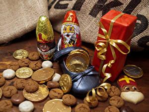 Обои Новый год Печенье Шоколад Сладости Подарков Дед Мороз