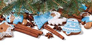 Фотография Новый год Печенье Корица Бадьян звезда аниса Белый фон Ветки Дизайн Продукты питания