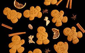 Обои Новый год Печенье Корица Бадьян звезда аниса На черном фоне Дизайна Пища