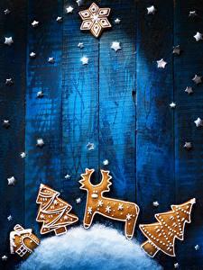 Картинки Рождество Печенье Олени Доски Дизайн Елка Снежинки Звездочки Продукты питания