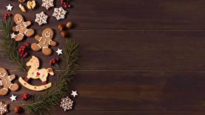 Фотография Рождество Печенье Фундук Ягоды На ветке Шаблон поздравительной открытки