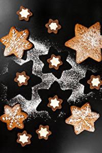 Фотография Новый год Печенье Сахарная пудра Серый фон Дизайн Снежинки Продукты питания