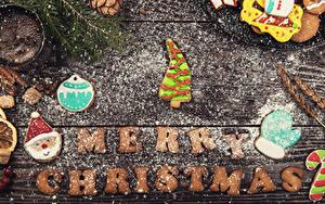 Фотография Новый год Печенье Сахарная пудра Доски Английский Дизайна Елка Санта-Клаус Рукавицы