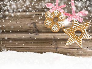 Фотографии Рождество Печенье Доски Снега Бантики 2 Шаблон поздравительной открытки Пища