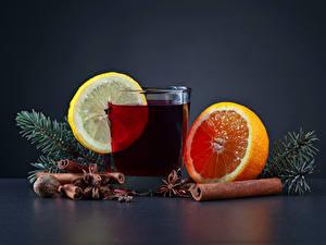 Картинки Новый год Напитки Цитрусовые Корица Орехи Апельсин Лимоны Стакан Ветвь Пища
